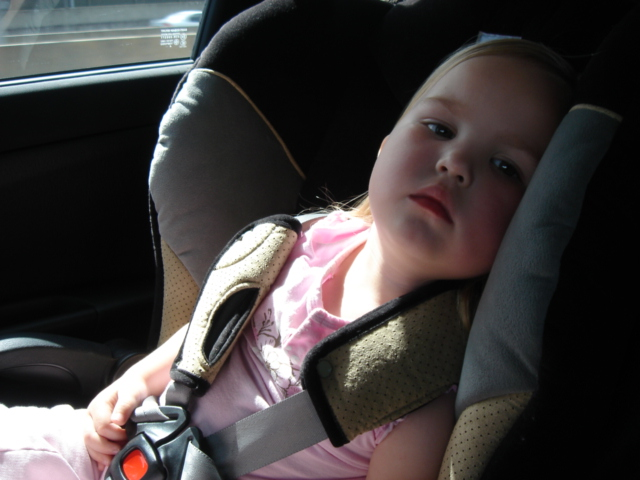Tired young child in baby seat